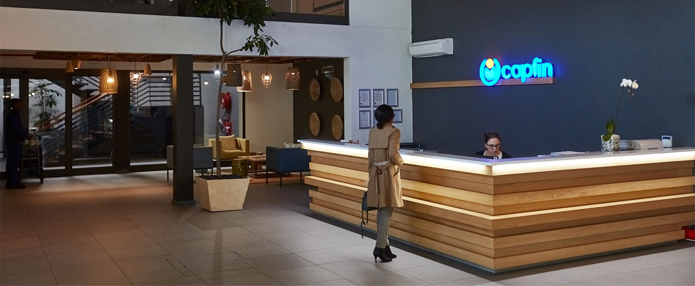 Capfin's receptionist in the foyer delivering service